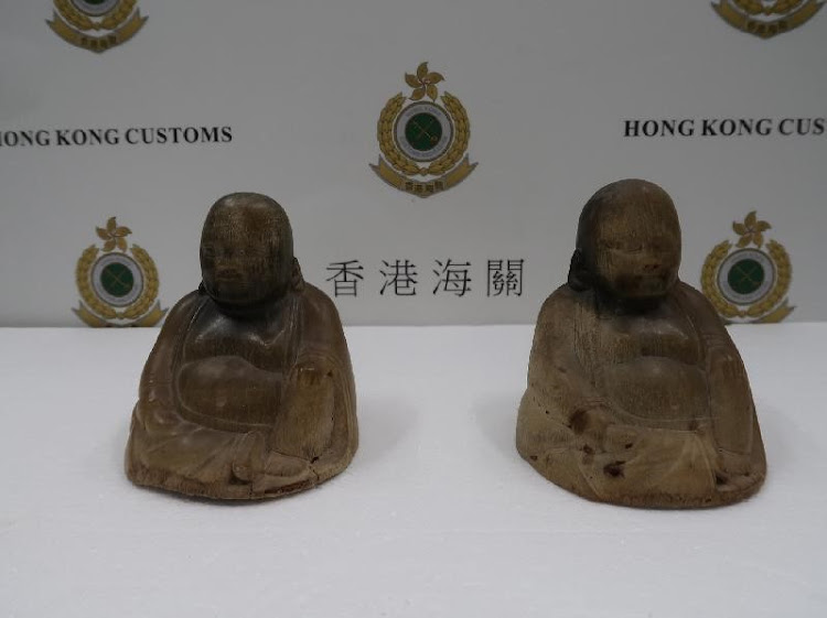 Two rhino horns, carved into the shape of Buddha, were seized in Hong Kong at the weekend after a female passenger from Spain allegedly tried to smuggle them through airport security systems hidden inside an electrical kettle.