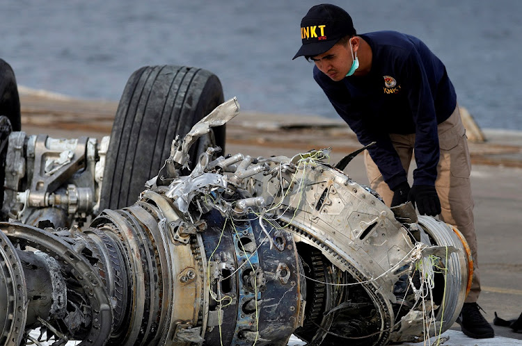 An Indonesian National Transportation Safety Commission official examines a turbine engine from the Lion Air flight JT610 at Tanjung Priok port in Jakarta, Indonesia, November 4 2018. Picture: REUTERS/BEAWIHARTA