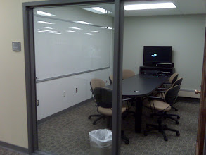 Photo: group study room with white board for work, flexible comfy seating, large screen for working on group projects