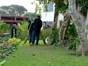 Photo: The minimum wage is about $3 to $4 a day.  These people are using brooms to sweep up leaves.