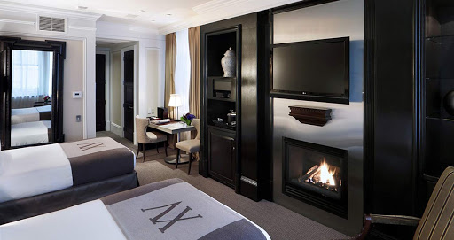 XV-Beacon-room.jpg - Named as one of the best hotels in the US by Travel & Leisure World's Best Awards 2016, the XV Beacon in Boston is known for its extensive art collection (including portraits from Gilbert Stuart) and its high-end comfort factor (gas fireplaces, cashmere throws).