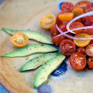Fresh Cherry Tomato Salad With Red Onions, Avocado and Pimentón.