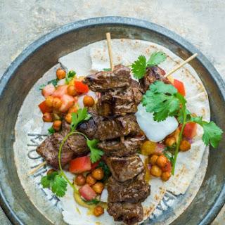 Beef Kebabs with Split Pea Hummus and Crispy Paprika Chickpeas.