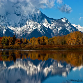 Oxbow Reflections by Brian Kerls - Landscapes Mountains & Hills ( mountain, fall colors, wyoming, western us, travel, hiking, alpine, light;, sky, iconic, nature, camping, autumn, trekking, tourism, beauty in nature, destination, outdoors, natural, outside, mt. moran, reflection, back packing, peak, landscape, grand tetons, usa, mirror, mountains, conservation, jackson, snake river, oxbow bend, dramatic, autumn colors, clouds, water, scenic, morning, environmental, national park, wilderness, blue, color, fall, summit, tetons, hike, peaks )