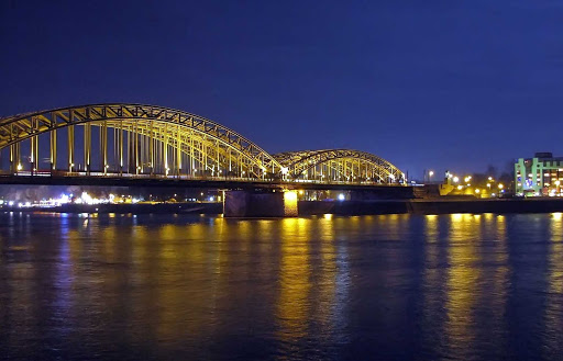 Cologne-Germany-bridge-at-night.jpg - A view of the Railway Bridge spanning the Rhine River in Cologne, Germany, at night.