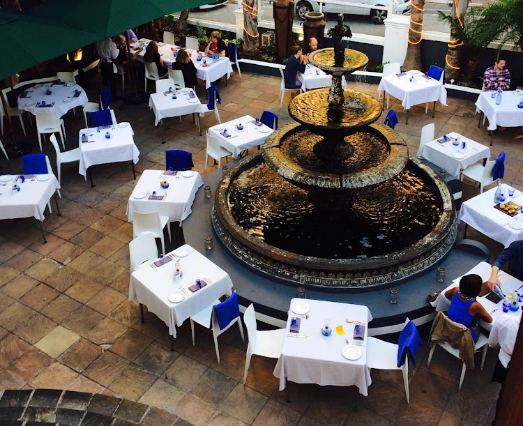 The sheltered courtyard is a lovely setting for La Mouette's Christmas lunch around the fountain.
