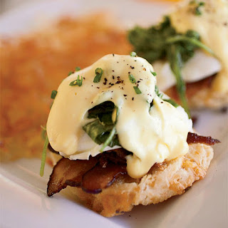 Eggs Benedict with Bacon and Arugula.