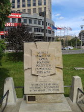 """Photo: A memorial marking the location of a Nazi atrocity, in this case, the execution of 120 people. These are scattered all across the city and serve as constant reminders of the brutality of the occupation. Notably, they all say that it was the """"Hitlerites"""" or """"Nazis"""" who committed the crimes spelled out, but not """"Germans"""". I like that."""