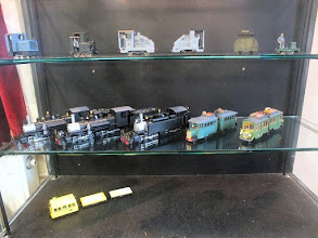 Photo: 007 Contents of the display case were provided by Phil Farr-Cox (top shelf) and Garry Whiting with a pair of railcar units and 3 of his very impressive mallet locos .