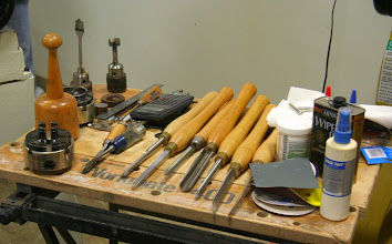 Photo: Always very organized, Allen brought a complete set of tools and materials necessary for the task and has them all neatly laid out, ready to use.  Note the spindle roughing gouge, a couple of parting tools, the parting/beading tool, and a couple of spindle and/or detail gouges.  Note also the Forstner bit and the modified space bit, both in Jacobs chucks.