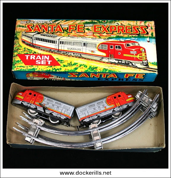 Photo: Alps 'Santa-Fe Express', Japan. Clockwork/Tinplate.   All tinplate clockwork train with fixed key. The set includes four sections of curved track that form a circle.  The box is 10.00 x 4.00 x 2.00 inches approx.  Visit my blog - Collecting Tin Toys at  http://tinplatetoys.blogspot.com/
