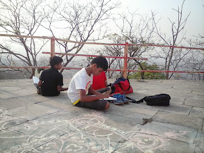 Photo: Outdoor Painting Atop a Hill