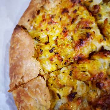 Caramelized onion and squash galette