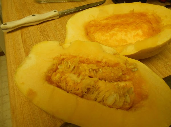 Wash and dry spaghetti squash. Cut off the bottom stem and discard. Cut the...