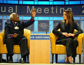 "Photo: NEW YORK,31JAN02 Desmond M. Tutu  (left), Archbishop Emeritus of South Africa, gestures while H.M. Quuen Rania of Jordania (right) listens during a session of the 32nd Annual Meeting of the World Economic Forum at the Waldorf-Astoria hotel in New York January 31, 2002. The session was simply titled ""For Hope"". 