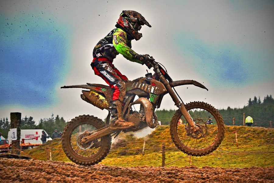 Jumping Into The Mud ! by Marco Bertamé - Sports & Fitness Motorsports ( mud, rainy, motocross, clumps, alone, race, competition, jump )