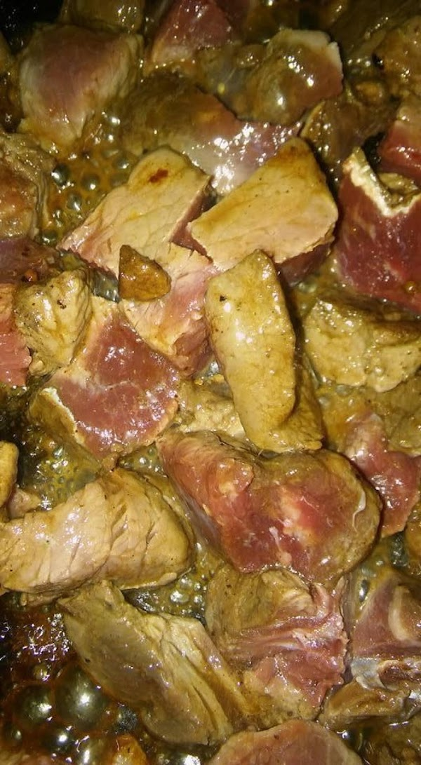 Browning of the meat pieces.