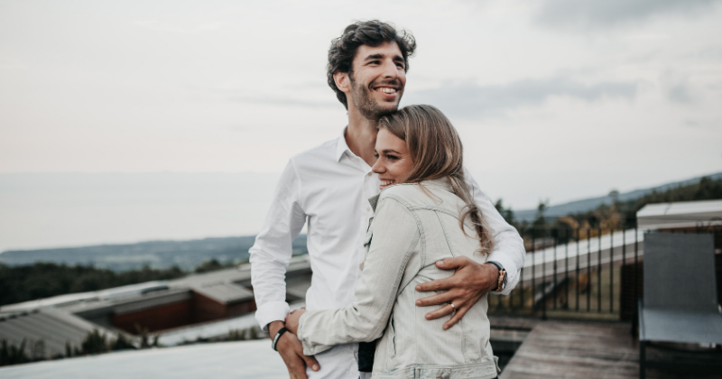 Couple hugging on a rooftop