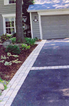 Photo: Vast chunks of asphalt can be overwhelming. Break it up with interlock banding. It can even be more eco-friendly with 'permeable' interlock which has built-in gaps.