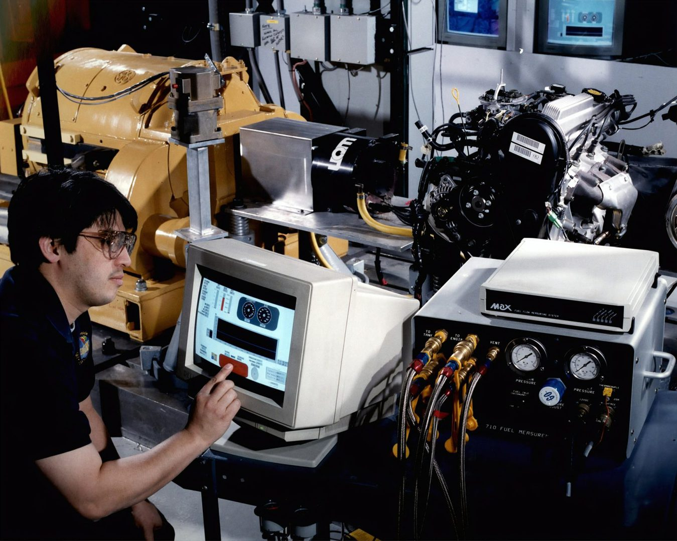Computer guy with lots of computers and cables