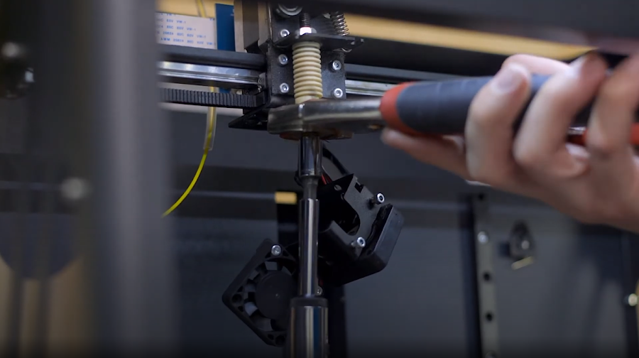 Changing a nozzle on the Craftbot XL using a socket wrench and channel locks.