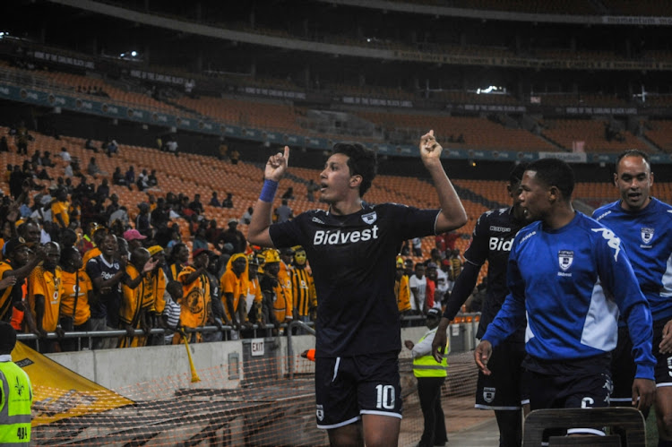 Ahmed Gamal Amr of Wits celebrates with teammates after scoring in the last minute to level the scoreline during the Absa Premiership match between Kaizer Chiefs and Bidvest Wits at FNB Stadium on September 16, 2017 in Johannesburg.