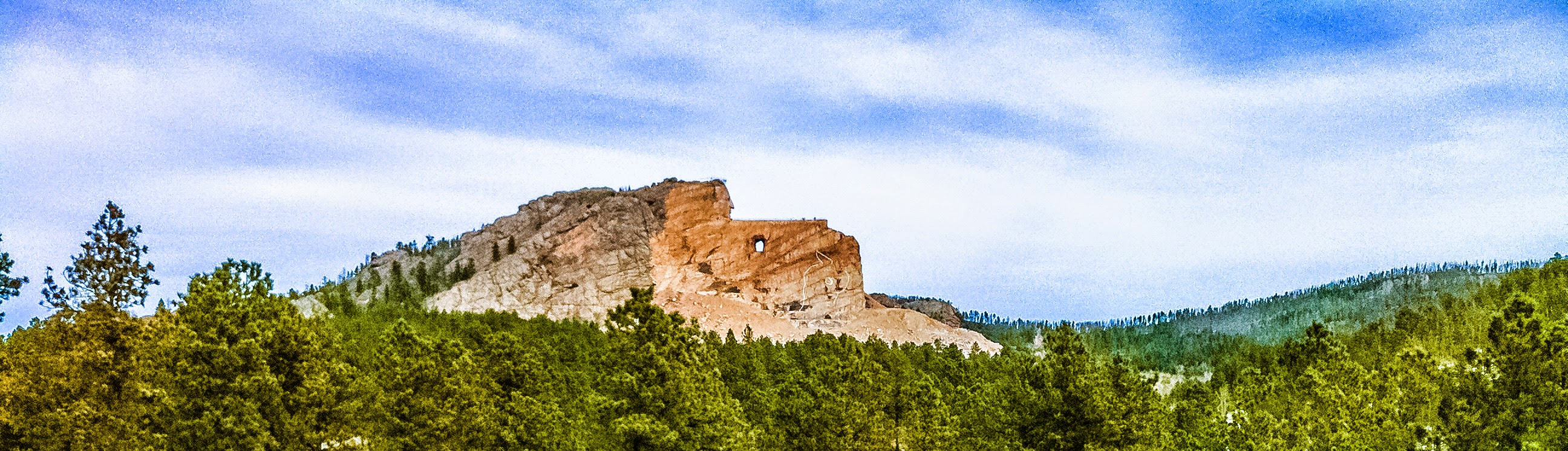 Photo: Crazy Horse Memorial A Long Time In The Making  It was 1949 when construction began on this memorial to the Native American hero, Chief Crazy Horse. The work is financed entirely by private funds. No government funds will be accepted.  The work so far was begun by the late sculptor Korczak Ziolkowski who was invited by Lakota Chief Henry Standing Bear and other Native American Elders to carve the mountain into the memorial. Ziolkowski's family has carried on the work since his death.  It appears that our visit missed a dynamite blast by just three days. That would have been something to see.  The Memorial is owned and operated by a non-profit foundation with the goal of not only completing the sculpting of the mountain, but the establishment of a Native American education complex and medical training center for Native Americans. More information is available here:  http://crazyhorsememorial.org/about-us/   This iPhone photo is an example of why you don't want to leave your main camera with its 36-200 zoom lens sitting on a chair in your living room when rushing out the door for a, possibly, once-in-a-lifetime visit to an historical area. Oh well. next time. Minimal processing done in #Lightroom5   #Travel   #CrazyHorse   #SouthDakota   #MountRushmore   #RapidCity     #FFA