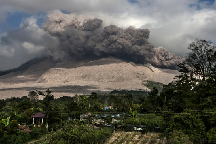 Mount Sinabung spews volcanic ash in Karo, as seen from Gamber village in Karo district, in North Sumatra, in this file photo. Sinabung is one of 129 active volcanoes in Indonesia, which sits on the Pacific Ring of Fire, a belt of seismic activity running around the basin of the Pacific Ocean.