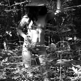 An English Country Garden by DJ Cockburn - Nudes & Boudoir Artistic Nude ( forest, south asian, full frontal, woman, art nude, front view, shadow, woodland, green hat, natural light, tree, grayscale, outdoor, dark hair, standing, full length, brunette, monochrome, anonymous, model, wood, black and white, anonymised, indian )