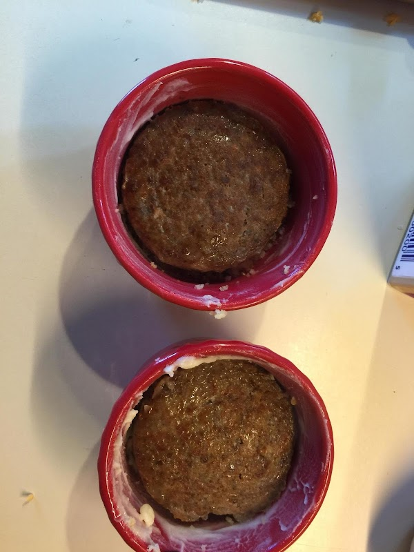 Add 1 slice of browned breakfast sausage to each ramekin and sprinkle 1tsp crumbled...