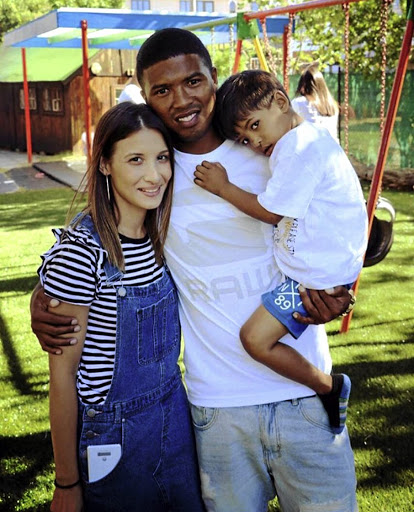 Sundowns midfielder Lyle Lakay with fiancée Danielle and son Luca.