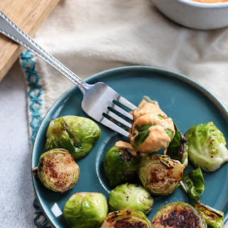 Skillet Cinnamon Brussels Sprouts with Spicy Pumpkin Aioli.