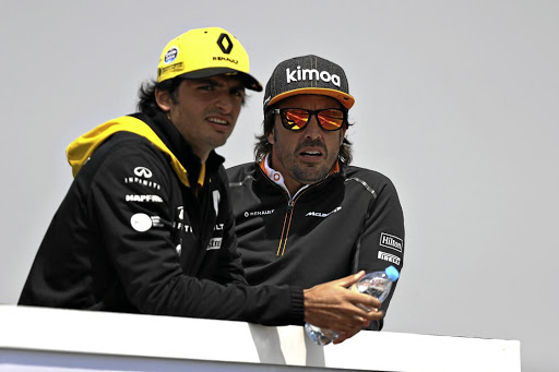 Renault link: Fernando Alonso, right, and Carlos Sainz, who is on a one-year loan to Renault from Red Bull. Picture: GETTY IMAGES