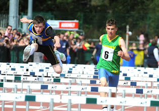 Photo: Daniel Ryan chasing down the National Boys U/14 75m Hurdles medalist at the National Community Games Finals