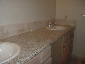 "Photo: bathroom marble counter top W/ 4"" back splash."