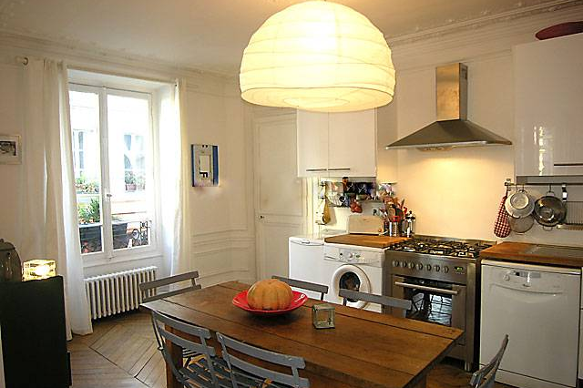Fully equipped kitchen at 3 bedroom Apartment Rue Du Cherche Midi, St Germain