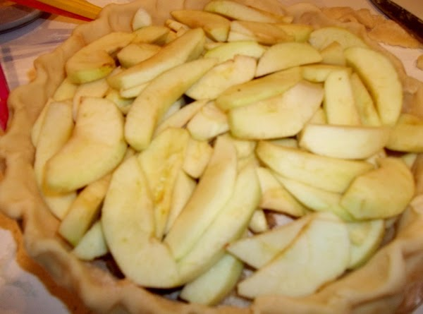 Top with 1/2 of the apples.  Sprinkle with half of the remaining sugar mixture and...