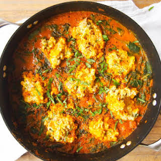 Chickpea Dumplings in Red Curry Coconut Spinach.