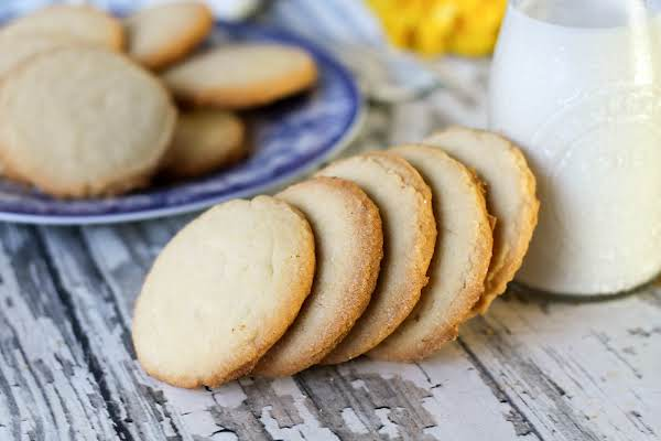 A Stack Of Grandma's Amish Cookies With Milk.
