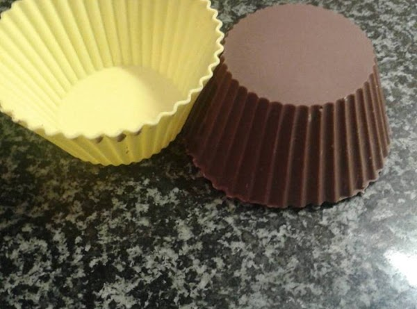 Once the cups are ready , very gently and slowly remove the chocolate cups...
