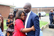 Harry Gwala district mayor Mluleki Ndobe with his wife Nobuhle outside the Umzimkhulu Magistrate's Court on March 25 2019. The state withdrew a charge of murder and two counts of attempted murder against him.
