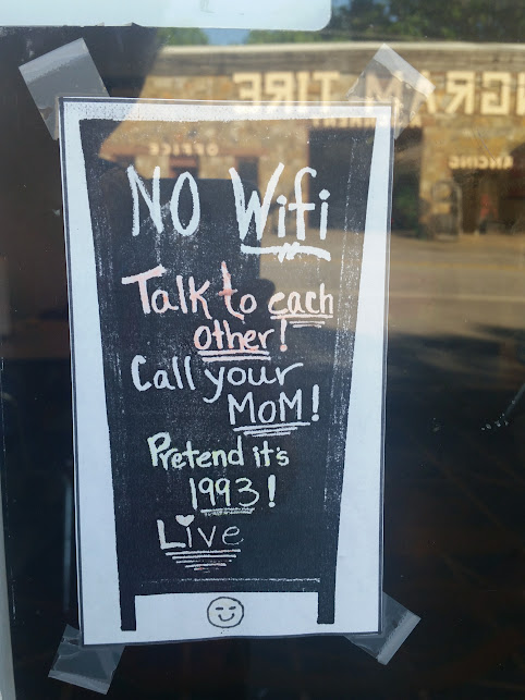 june's cafe sign: no wifi, talk to each other!