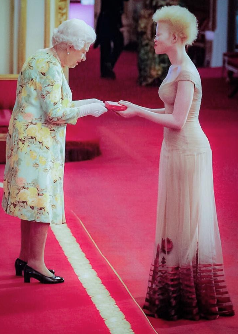 Siphosethu Mbuli, 24, receives a Queen's Young Leaders Award from Britain's Queen Elizabeth