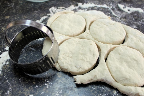 Flour a countertop, cutting board or something like that. Scoop out the dough and...