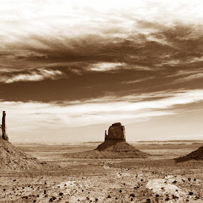 The Old West by Alex Cassels - Landscapes Travel ( sepia, desert, nature, monument valley tribal park, arizona, sandstone buttes, travel, landscape, the mittens, united states, alex cassels, iconic landmark )