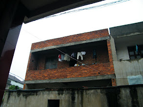 Photo: the bare conceret house in front of elder sister's house.