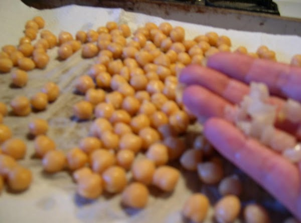 Drizzle the olive oil over the beans and use your hands or a spatula...