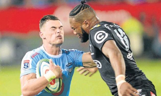 Jesse Kriel, of the Bulls, and Lukhanyo Am, of the Sharks, during the Super Rugby match at the Loftus Versfeld Stadium in Pretoria on Saturday