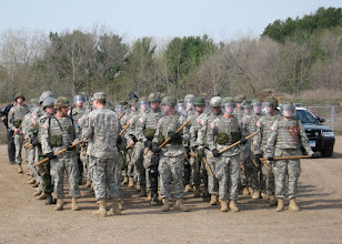 Photo: Soldiers prepare themselves in formation during a civil disturbance exercise the 34th Military Police Company conducted with the Stillwater Police Department Apr. 22 in Stillwater, Minn.