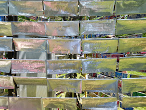 Photo: The Bell Tower is constructed of hundreds of flattened beer cans, on which people are invited to write their own inscriptions.